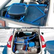 Снегоход Хаски в багажнике автомобиля